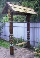 Качеля деревянная с резьбой и росписью в русской традиции для сада