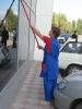 Мытьё витрин, рекламных вывесок (не выше 2 метров)